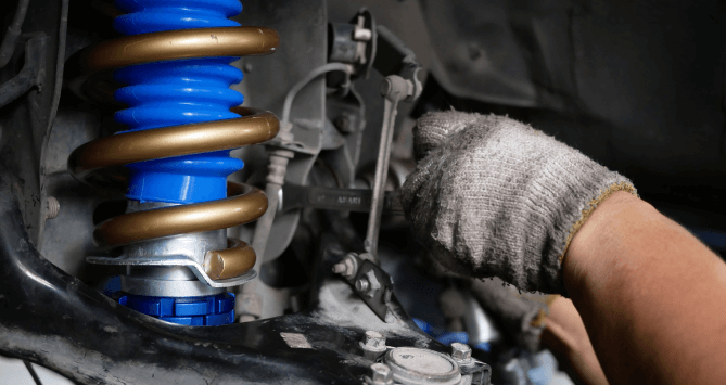 Shock absorbers and struts